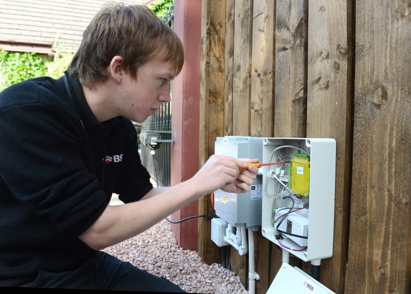 Ian inspecting a security box